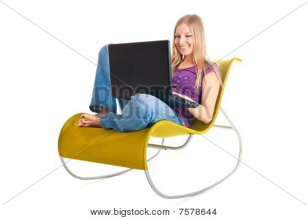 Woman On Chair With Laptop