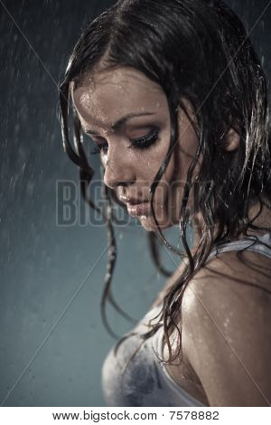 Young Woman Under The Rain