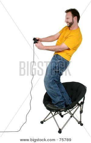 Casual Man Playing Computer Games Over White
