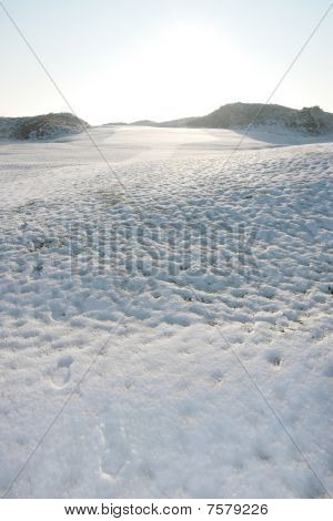 Footprints On A White Snow Covered Links Golf Course