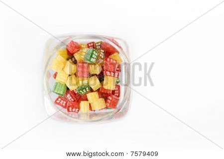 Delicious Sweet Candies In Sugar In A Glass Jar. White Background