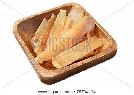 Wooden Dish With Pieces Stockfish Isolated On White Background.