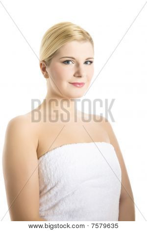 Young Beautiful Woman With Pure Healthy Skin In A Towel