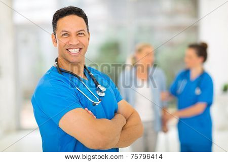 good looking middle aged health worker with arms crossed