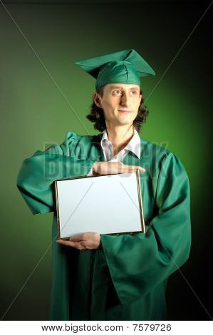 Portrait Of A Successful Man On His Graduation Day In Green Clothes And A Hat