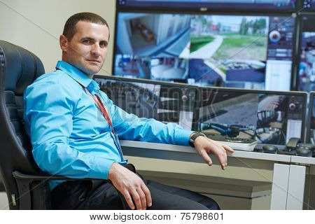 security executive chief in front of video monitoring surveillance security system