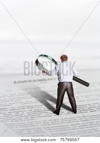 Businessman finds something with loupe