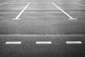 stock photo of parking lot  - Vacant parking place an empty space on asphalt pavement with white road marking - JPG