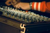 stock photo of recording studio  - Musician hands over audio panel - JPG