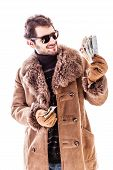 picture of hustler  - a young man wearing a sheepskin coat isolated over a white background holding Euro banknotes - JPG