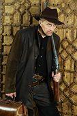foto of bandit  - Bandit with gun in the wild west - JPG