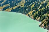 stock photo of shan  - Spectacular scenic Big Almaty Lake Tien Shan Mountains in Almaty KazakhstanAsia at summer