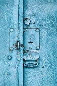 picture of hasp  - Close up of padlock and old metal hasp and staple on an vintage door