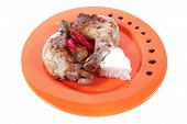 foto of thigh highs  - grilled chicken thighs on orange plate with white rice and red hot chili pepper isolated over white background high resolution - JPG