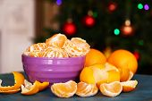 foto of tangerine-tree  - Sweet tangerines and oranges on table on Christmas tree background - JPG