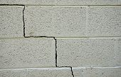 stock photo of cinder block  - Crack in a cinder block building foundation - JPG