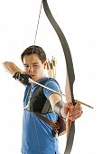 image of longbow  - Boy with blue shirt and jeans shootling with a longbow - JPG