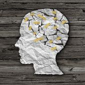 picture of neurology  - Brain disease therapy and mental health treatment concept as a sheet of torn crumpled white paper taped together shaped as a side profile of a human face on wood as a symbol for neurology surgery and medicine or psychological help - JPG