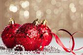 stock photo of natal  - Christmas ball on shiny background - JPG