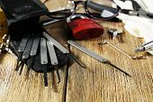picture of pick-lock  - Tools of picking locks on wooden table - JPG