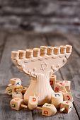 stock photo of dreidel  - Jewish Holiday Hannukah Symbols - Menorah And Wooden Dreidels. Copy Space Background. ** Note: Shallow depth of field - JPG
