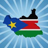 image of sudan  - South Sudan map flag on blue sunburst illustration - JPG