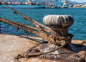 stock photo of bollard  - bollard with thick ropes in a harbour - JPG