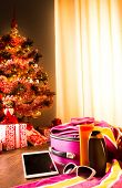 picture of sun tan lotion  - Christmas sun holidays with tablet luggage sunglasses and sun lotion decorated tree on background - JPG