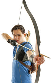 picture of longbow  - Boy with blue shirt and jeans shootling with a longbow - JPG