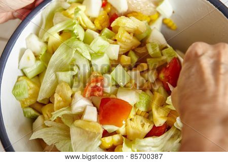 Mixing all the salad ingredients