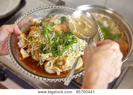 Lontong mie in Indonesian for its famous traditional food, or in English maybe spelled rice cake and noodle in vegetable soup