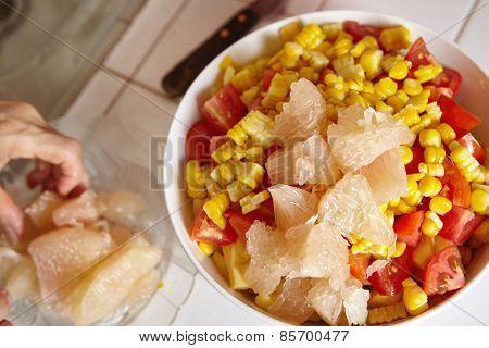 Preparing fresh fruits for salad