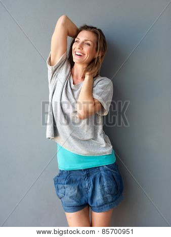One Attractive Mid Adult Woman Smiling With Hands In Hair