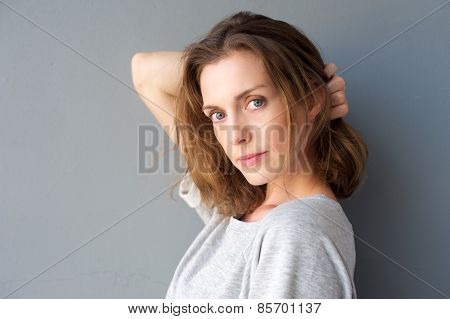 Elegant Mid Adult Woman Posing With Hand In Hair