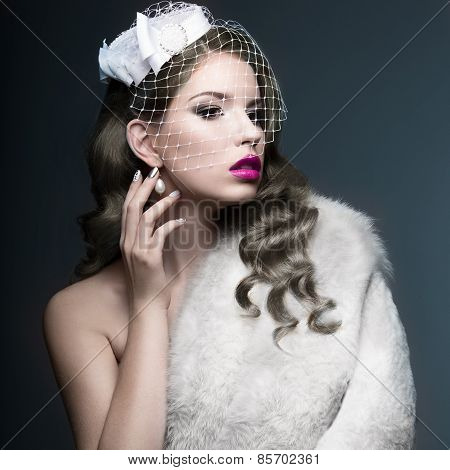 Elegant beautiful girl with silver curls and a veil. Winter image. Beauty face.
