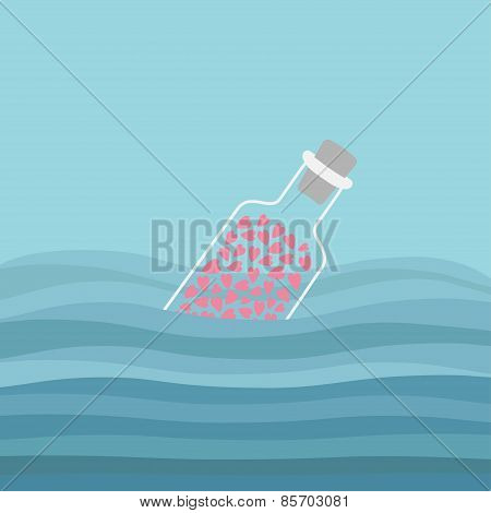 Bottle With Hearts Inside In The Ocean Sea Water And Waves. Love Background.