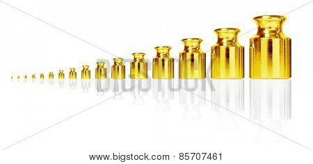 Golden weight set isolated on white.