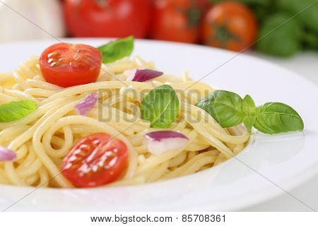 Spaghetti Noodles Pasta Meal With Tomatoes And Basil On Plate