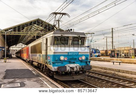 Narbonne, France - January 06: Passenger Train Hauled By Electric Locomotive At Narbonne Station On