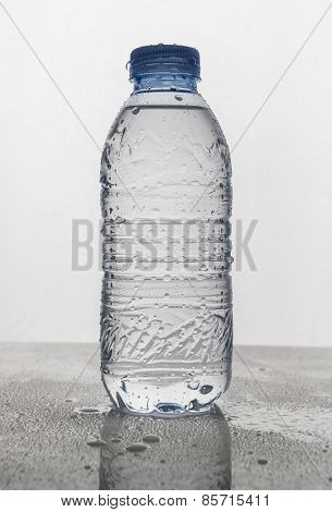 Ice cold mineral water bottle with water droplets