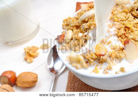 Milk Falling On A Bowl Full Of Cereal