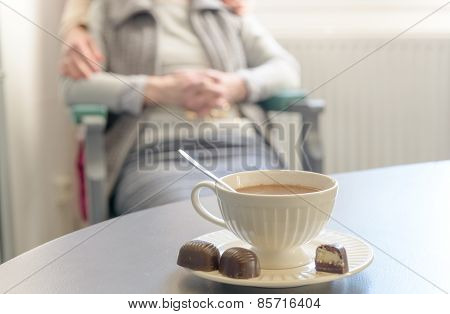 Cup Of Hot Chocolate With Senior Woman