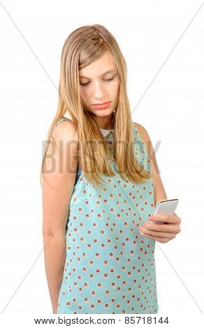 Teenage Girl Standing With A Phone In His Hand