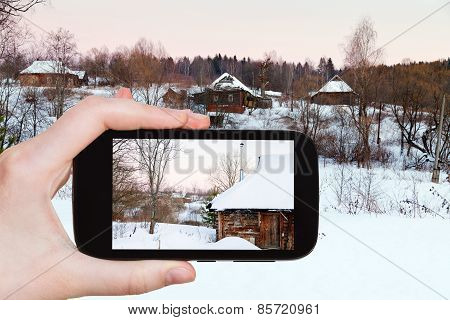 Tourist Photographs Of Snowy Wooden Houses
