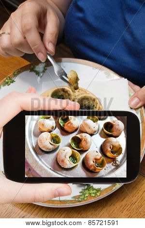 Tourist Photographs Hot Plate Of Escargot Shells