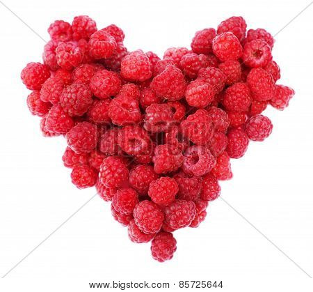 Red raspberries heart shape isolated.