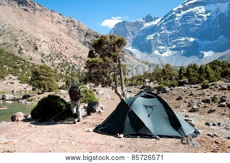 Man Next To Tent In The Mountains.
