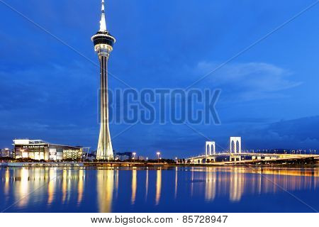 Urban landscape of Macau with famous traveling tower under sky near river in Macao, Asia.