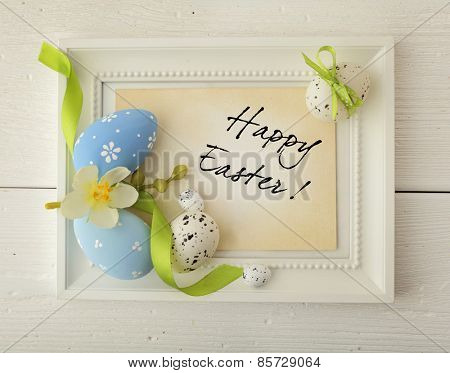 easter frame with copy space. colorful easter eggs and spring flowers