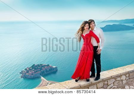 Young Couple Embraccing Over The Sea On Romantic Travel Honeymoon Vacation Summer Holidays Romance.